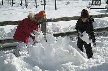 Whitby Students building a snow structure on a Snow Day